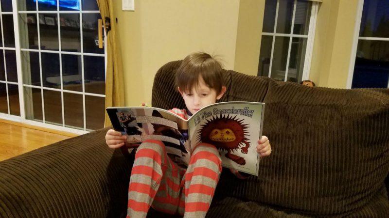 Boy Reading Eli the Snazzleraffer